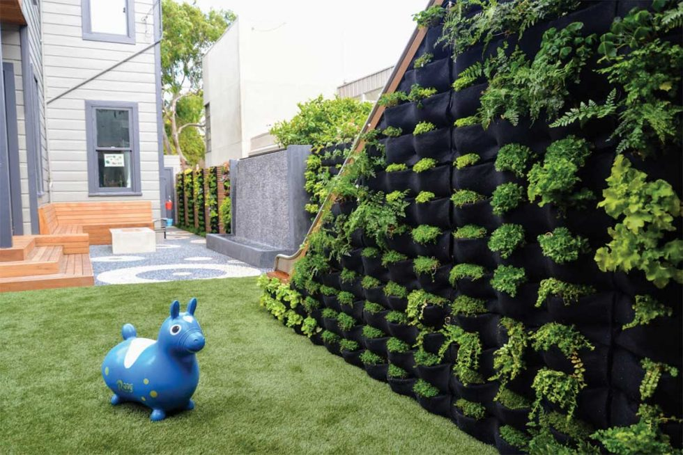 Florafelt Pockets vertical garden on a children's slide for a San Francisco backyard by Monica Viarengo.